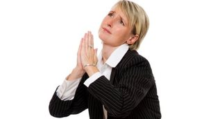 woman in suit praying