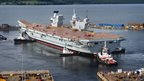 HMS Queen Elizabeth is floated for the first time.