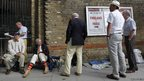 Cricket fans queue outside Lord's cricket ground in London