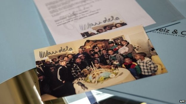 A photo signed by late South African President Nelson Mandela with the latter posing with late US pop star Michael Jackson is displayed on July 15, 2014