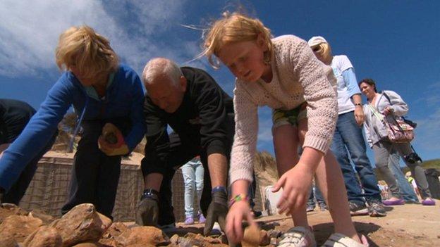 Volunteers work on the sea defences at Hemsby