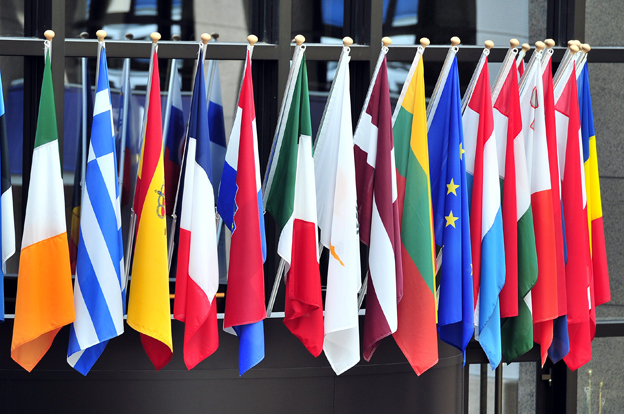 flags of European countries above the entrance of the European Council on May 21,2014 in Brussels