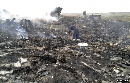 An Emergencies Ministry member works at the site of a Malaysia Airlines Boeing 777 plane crash in the settlement of Grabovo