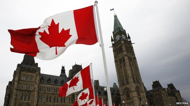Canadian flags lined the road around Parliament Hill in Ottawa, Canada, on 9 May 2014
