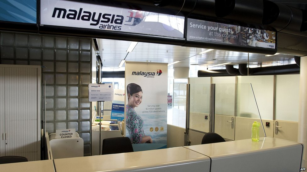 A closed Malaysia Airlines counter at the Schiphol airport near Amsterdam, 17 July 2014