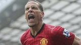 Rio Ferdinand celebrates scoring at Old Trafford.