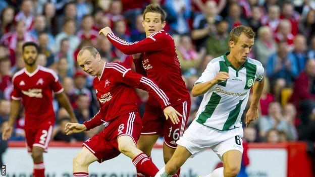 Groningen's Maikel Kietenbeld turns away from Aberdeen pair Willo Flood and Peter Pawlett