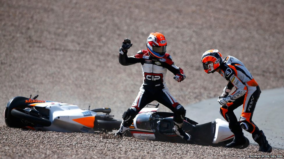 Mahindra Moto3 rider Bryan Schouten (left) of the Netherlands clashes with Kalex KTM Moto3 rider Scott Deroue