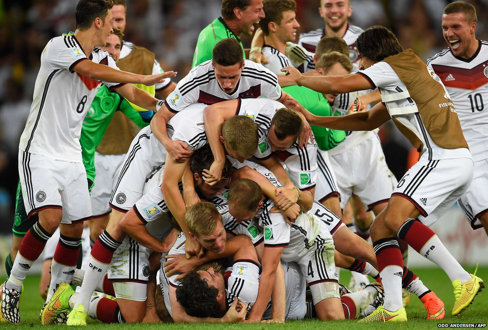 Germany's players pile up on top of each other as they celebrate victory
