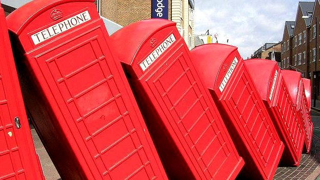 "A Kingston landmark since December 1989, the twelve tumbling phone boxes are an artwork called ""Out of Order"". It's one of the earliest works of David Mach, a Royal Academician and a leading figure in contemporary ""site specific sculpture""."