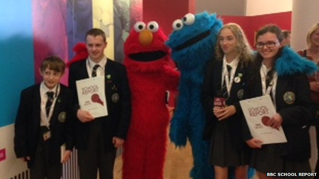 Elmo and the Cookie Monster from Sesame Street stopped to chat to the School Reporters
