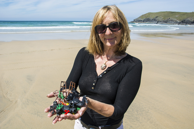 Tracey with Lego haul on beach