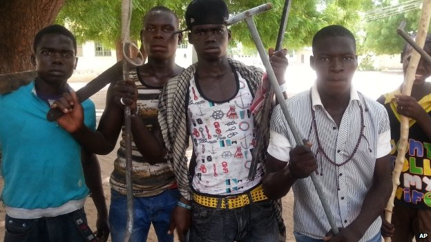 Vigilantes youths pose for a photographs in Maiduguri, Nigeria - April 2013