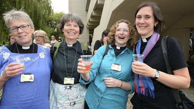 Women clergy celebrating after CofE general synod voted to allow women bishops. The one on the rights is Rev Kat Campion-Spall