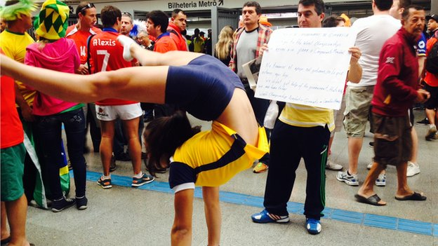 A gymnast attempts to raise money from football fans in Sao Paulo to compete at Rio 2016