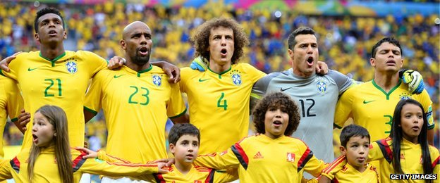 Brazilian players sing the national anthem in Brasilia on 12 July