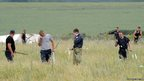 People search for bodies at the  crash site of a Malaysia Airlines jet