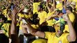 Brazil fans celebrate their team scoring during the World Cup