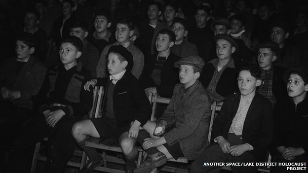 The Boys watch a film in 1945