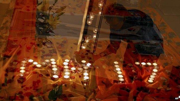 A candlelit vigil outside Kuala Lumpur, Malaysia, 18 July