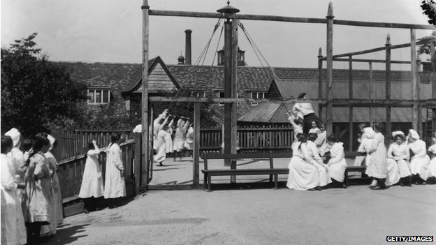 Girls playing at one of the schools in Bournville Village near Birmingham, a new town founded by Chocolate manufacturer and social reformer George Cadbury, July 1909