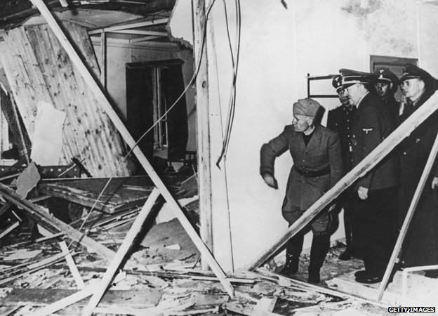 Mussolini and Hitler inspect the wreckage of the conference room after the bomb