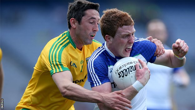 Rory Kavanagh battles with Monaghan's Kieran Duffy in the Division 2 League final in April