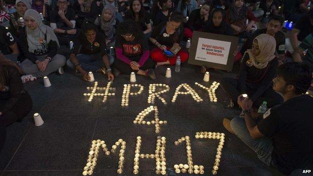 A vigil is held in Kuala Lumpur, Malaysia, 18 July