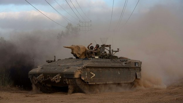 A convoy of Israeli armoured personnel carriers move towards the Gaza border - 18 July 2014