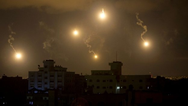 The skies above Gaza are lit up by flares amid the continuation of Israel's ground offensive - 19 July 2014