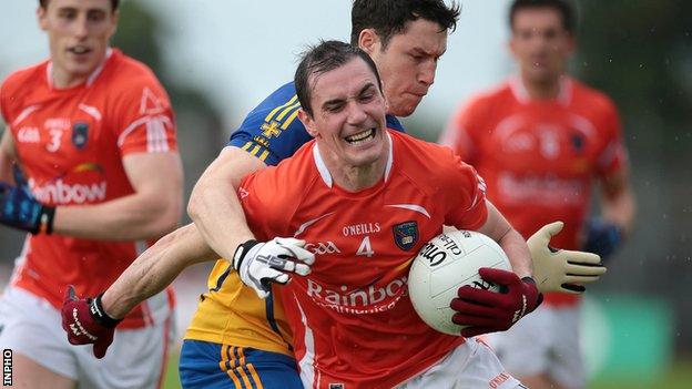 Roscommon's David O'Gara challenges Armagh's Andy Mallon at Dr Hyde Park