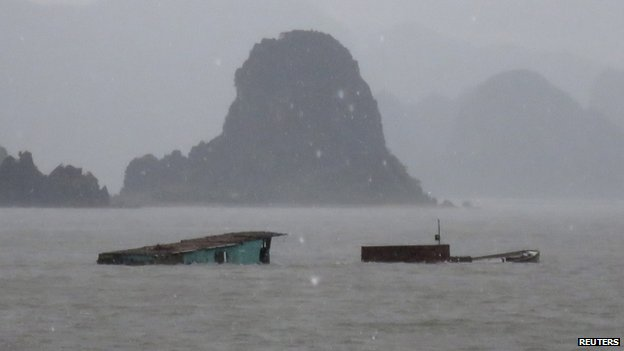A sunken boat off Vietnam's Van Don island, 19 July