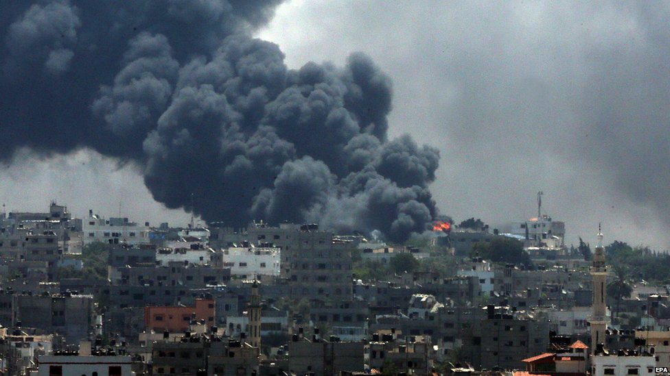 Smoke rises from the Shejaiya neighbourhood during an Israeli military operation in the east of Gaza City, 20 July 2014