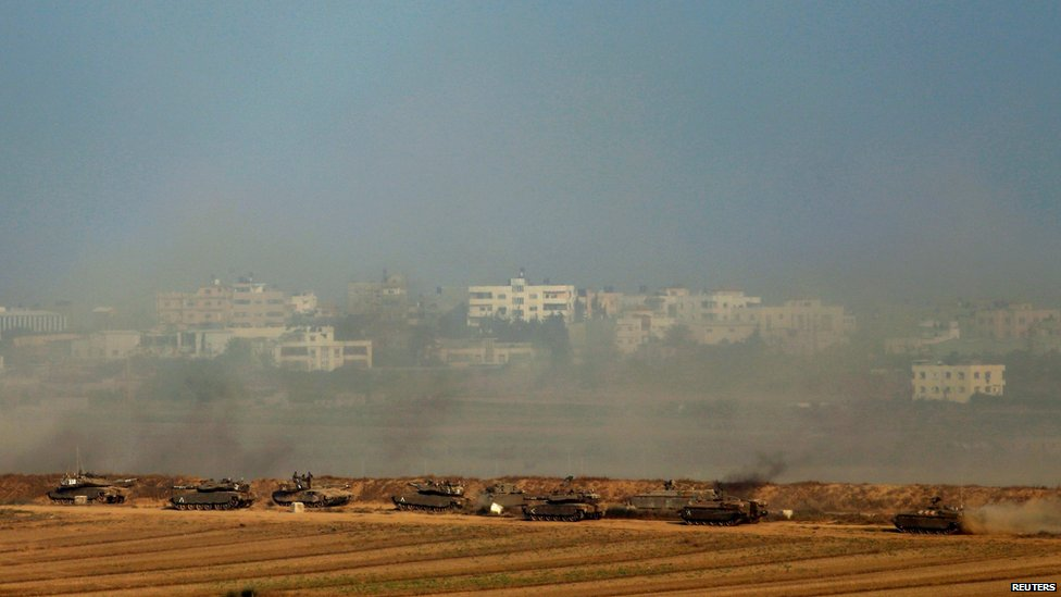 Israeli tanks are seen along the border with Gaza July 20, 2014