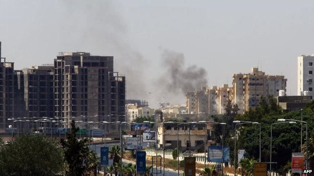 Smoke billows from the site of clashes on the road leading to the airport in the Libyan capital Tripoli, 20 July 2014