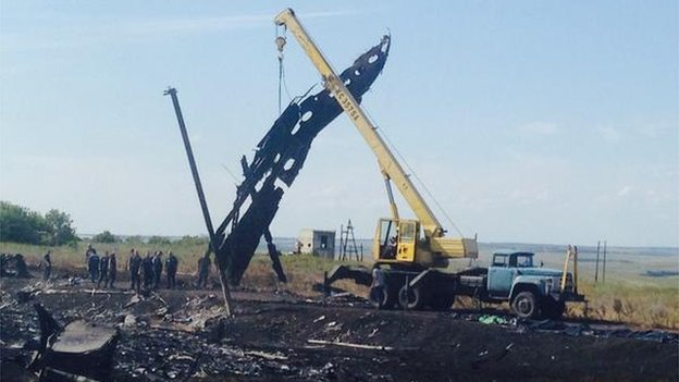 A crane could be seen at the crash site lifting large pieces of wreckage