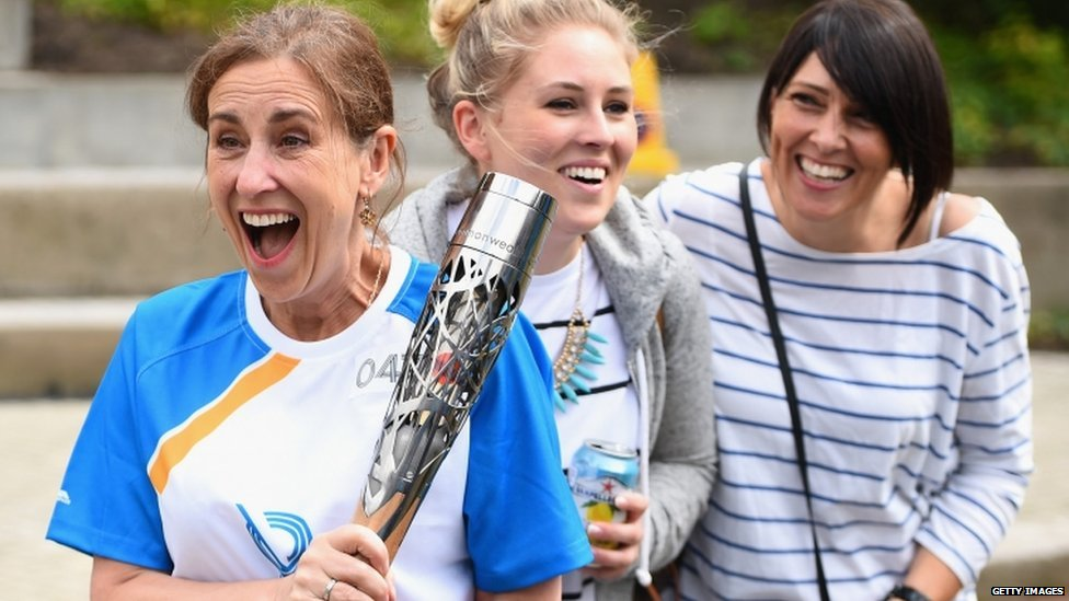 Broadcaster Kirsty Wark carries the Queens Baton Relay as it arrives in Glasgow