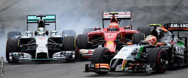 Lewis Hamilton collides with Kimi Raikkonen at the German Grand Prix.