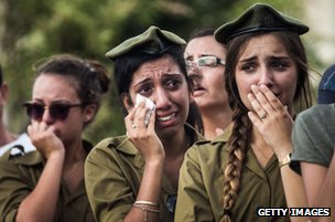 Mourners at the funeral of Sergeant Adar Barsano during his funeral in Nahariya, Israel, 20 July