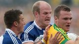 Donegal's Neil McGee attempts to burst away from Ryan Wylie and Dick Clerkin