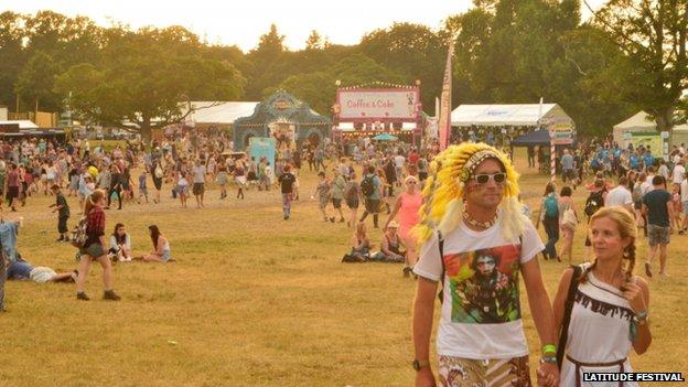 Dusk falls over festival-goers