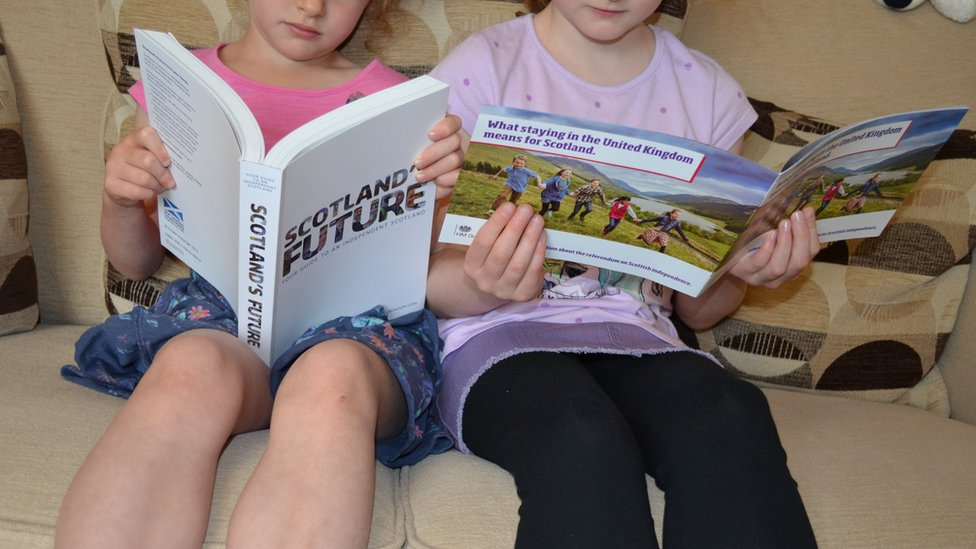 Children reading referendum -related material