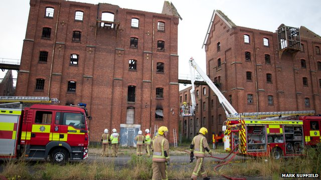 Damaged buildings at Bass Maltings