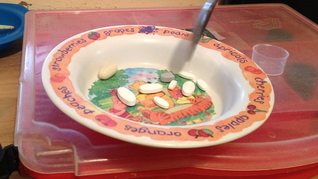 Children's bowl with pills in it