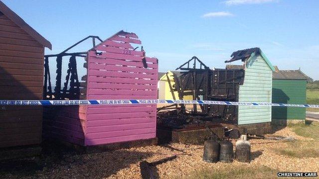 Fire damaged beach huts at Calshot
