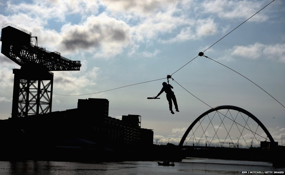 Nina Saunders makes her way across a zip wire over the river Clyde in Glasgow, Scotland