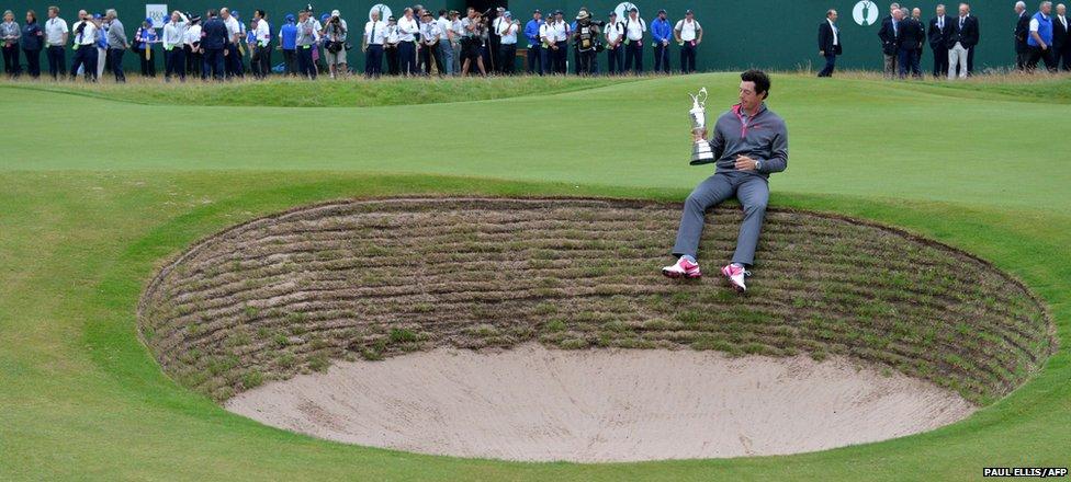 "Northern Ireland""s Rory McIlroy holds the Claret Jug as his poses for a photographs"