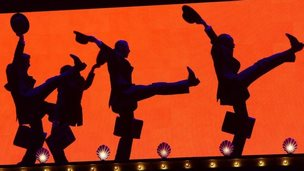 Dancers perform on the closing night of Monty Python Live (Mostly) at The O2 Arena in London, England