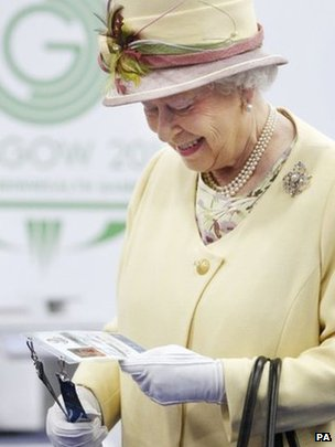 The Queen is presented with a pass for the Commonwealth Games