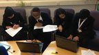 Students working on a report